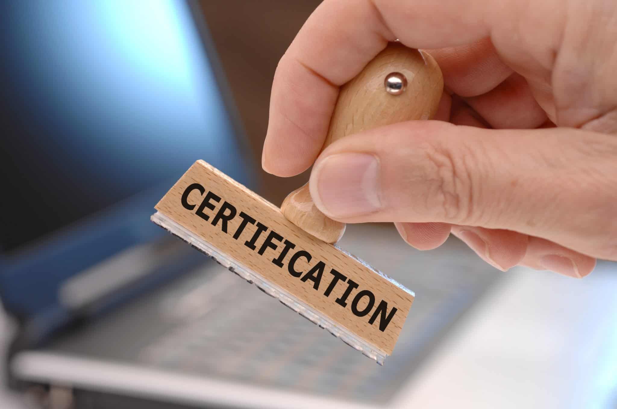 rubber stamp in hand marked with certification